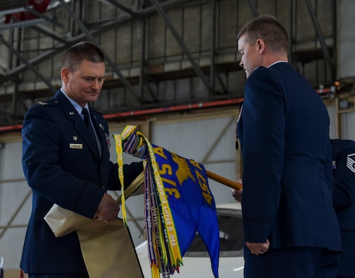 Col. Kevin Schiller, 375th Operations Group commander, and Lt. Col. Royce Lippert, 457th Airlift Squadron commander, furl the 457th flag during an inactivation ceremony at Joint Base Andrews, Maryland, June 14, 2019. The 457th AS was first stood up as the 457th Heavy Bombardment Squadron on July 1, 1942, and was responsible for training stateside aircrews in the B-17 Flying Fortress and B-24 Liberator. (U.S. Air Force photo by Senior Airman Chad Gorecki)