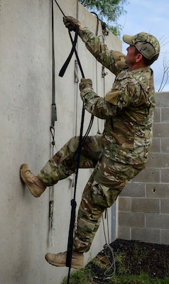 Master Sgt. Travis Mooney, 66th Training Squadron, Det. 3 cadre, demonstrates how to use survival items or debris to safely scale a wall in an isolation or evasion-type environment, June 3. Survival, evasion, resistance and escape cadre from are responsible for both the four-day Evasion and Conduct After Capture Course and the 15-day SERE Specialist Training Orientation Course at Joint Base San Antonio-Lackland. ECAC was the first stop for recruiters from the 330th RCS who travelled from across the United States to attend this biannual squadron training intended to immerse recruiters into SERE training in order for them to be better able to recruit Air Force SERE candidates.