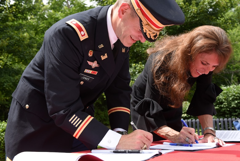Lt. Col. Cullen Jones, U.S. Army Corps of Engineers Nashville District commander, and Mayor Paige Brown sign a project partnership agreement June 14, 2019 in Gallatin, Tenn., which clears the way for the Corps to begin the design and implementation phase for a flood risk reduction project to help alleviate flooding during periods of heavy rain. (USACE photo by Lee Roberts)