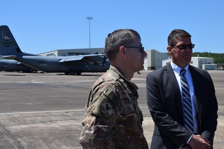 Two Airmen talk on the flight line