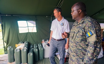 Major J. Browne from the Barbados Defence Force shows the Role 1 field hospital to Mr. Douglas Fitzgerald from United States Southern Command.