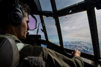 "U.S. Marine Corps Capt. Anthony Gutierrez, a KC-130J Super Hercules pilot with Marine Aerial Refueler Transport Squadron 152, observes the terrain of the Joint Pacific Alaska Range Complex during  Exercise Kodiak Mace, Alaska, May 25, 2019. VMGR-152 provides additional flexibility for III Marine Expeditionary Force, enhancing a forward-deployed ""ready force"" in the Indo-Pacific through aerial refueling and assault support."