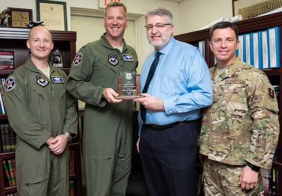 (From left) Col. Mark Robinson, 12th Flying Training Wing commander, Chief Master Sgt. Antonio Goldstrom, 12th FTW command chief, and Lt. Col. Ryan Chute, 12th FTW director of staff, present Lane Bourgeois, 12th FTW historian, with the 2019 Wing Excellence in History Programs award from Air Education and Training Command at Joint Base San Antonio-Randolph June 12. Lane was recognized for his critical thinking presentations and for being the first wing to produce a historical study in the new format.