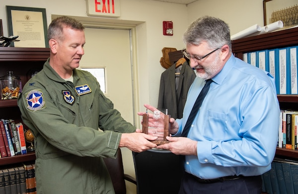 Col. Mark Robinson (left), 12th Flying Training Wing commander, presented Lane Bourgeois (right), 12th FTW historian, with the 2019 Wing Excellence in History Programs award from Air Education and Training Command at Joint Base San Antonio-Randolph June 12. Lane was recognized for his critical thinking presentations and for being the first wing to produce a historical study in the new format.
