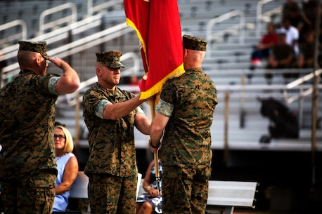 Lt. Gen. Robert F. Hedelund passes the colors to Lt. Gen. Brian D. Beaudreault during a change of command ceremony at Camp Lejeune, N.C., July 13, 2019. During the ceremony, Hedelund relinquished his post as commanding general of II MEF to Beaudreault. (U.S. Marine Corps photo by Sgt. Sean J. Berry)