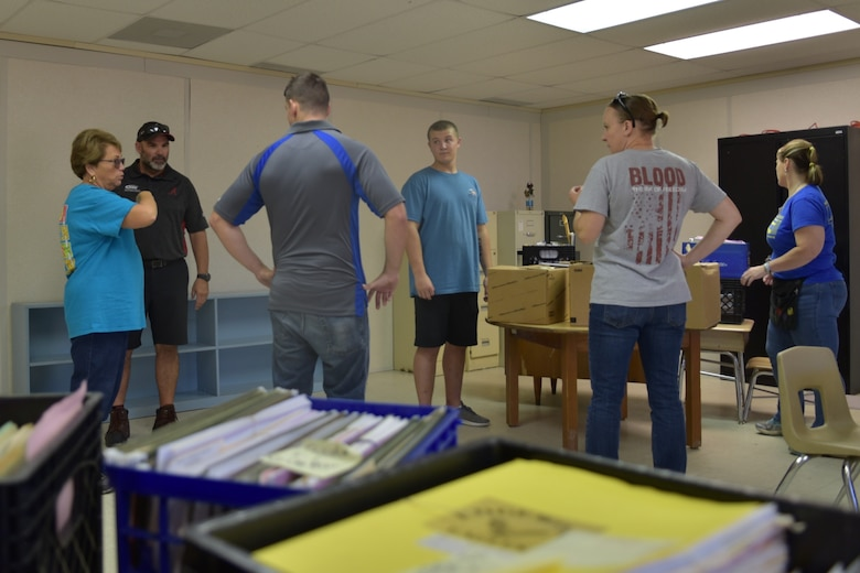 Wendy Hooks, Meadow Lane Elementary School Principal, right, explains the moving plan to Airmen assigned to Seymour Johnson Air Force Base and locals June 14, 2019, in Goldsboro, North Carolina.