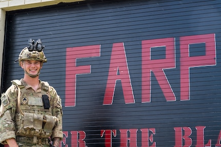 Staff Sgt. Christopher Stuebbe, 628th Logistics Readiness Squadron forward area refueling point team chief, poses in front of his team's sign June 17, 2019, at Joint Base Charleston, S.C.