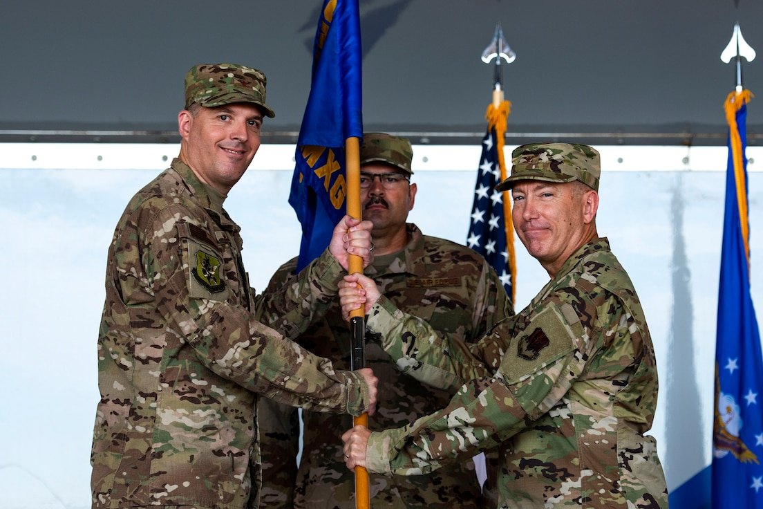 Col. Daniel P. Walls, left, 23d Wing commander, presents the 23d Maintenance Group (MXG) guidon to Col. Stephen Harvey, 23d MXG commander, during a change of command ceremony, June 17, 2019, at Moody Air Force Base, Ga. Harvey joins Moody from Kadena Air Base, Japan, where he was the deputy commander for the 18th Maintenance Group, leading Airmen who maintained combat capabilities for 80 assigned aircraft. (U.S. Air Force photo by Senior Airman Erick Requadt)