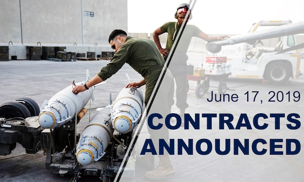 "Two service members observe three missiles sitting on a transport crate. Words over photo reads: ""June 17, 2019 Contracts Announced."""