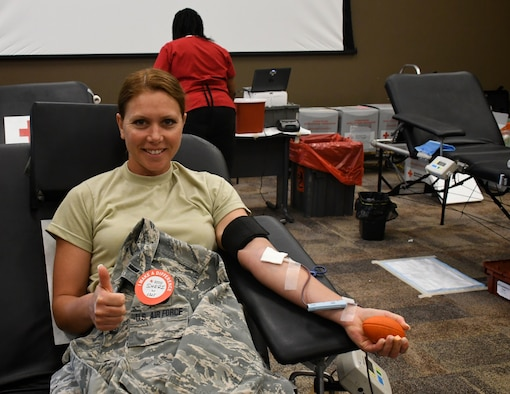 Airmen of the 932nd Airlift Wing are proud to help others in the Saint Louis region and Belleville local community. 1st Lt. Sheri Mason-Rogier, 932nd Mission Support Group executive officer, assisted the American Red Cross as they set up a blood donation center inside the 932nd Airlift Wing auditorium June 13, 2019, at Scott Air Force Base, Ill. Volunteers from the USO in Saint Louis and nearby towns also came and provided snacks and drinks for donors. Mason had no hesitations to her universally-accepted blood again.  Some donors' blood can only go to people of the exact same type, but anyone can use Mason-Rogier's, which makes it even more important.