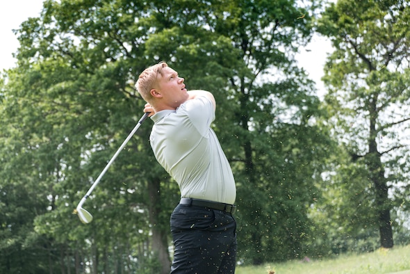 Staff Sgt. Justin Wielock, of the 103rd Civil Engineer Squadron, East Granby, Connecticut, swings his golf club June 1, 2019 at the Bogies for the Brave's golf tournament at the Hunter Golf Club in Meriden, CT. Wielock sliced the grass with his swing and pushed the gold ball through the air and onto the green. The tournament was hosted by the non-profit organization Bogies for the Brave. (U.S. Air National Guard photo by Airman 1st Class Chanhda Ly)