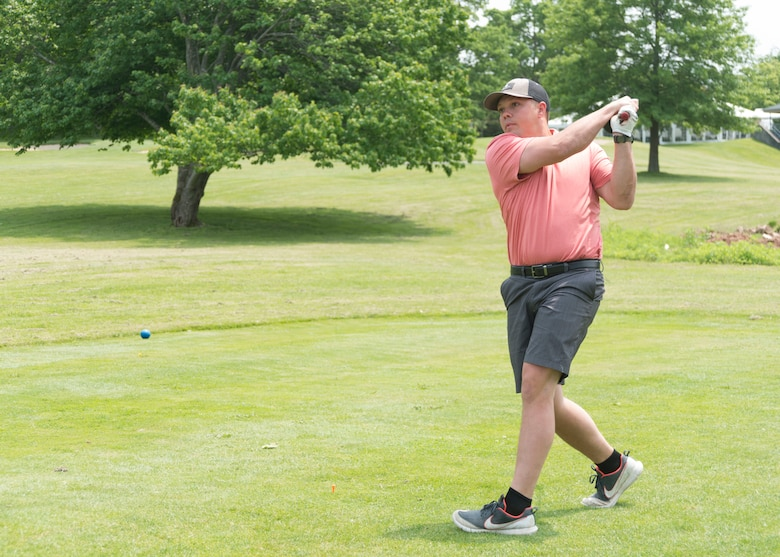 Senior Airman Eric Adamczyk of the 103rd Civil Engineer Squadron, East Granby, Connecticut, swings his golf club June 1, 2019 at the Bogies for the Brave's golf tournament at the Hunter Golf Club in Meriden, CT. Adamczyk putted the ball into the 11th hole. The tournament was hosted by the non-profit organization Bogies for the Brave. (U.S. Air National Guard photo by Airman 1st Class Chanhda Ly)