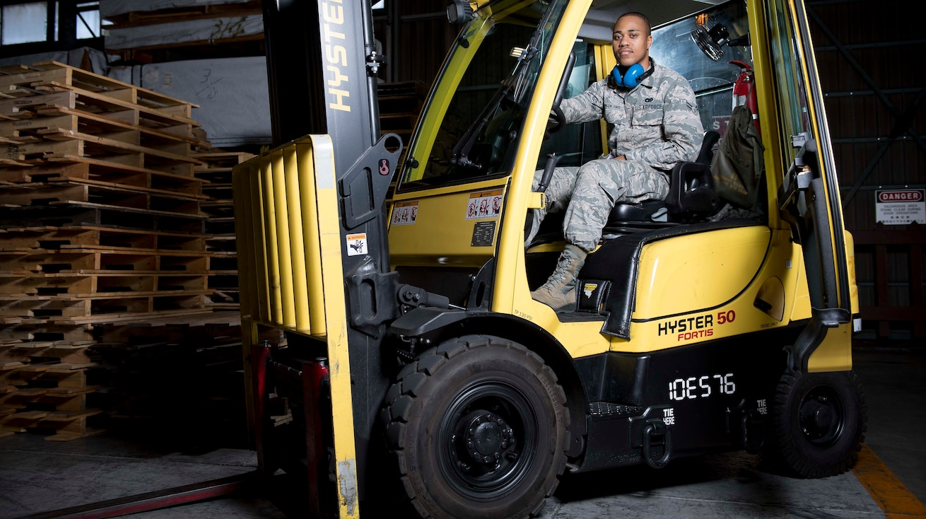 Airman 1st Class Anderson Arlington-Davis, 374th Logistics Readiness Squadron outbound cargo specialist, poses for a photo, Dec. 22, 2017, at Yokota Air Base, Japan. Arlington-Davis received the 374 AW award of Airlifter of the Week for his leading example and embodiment of the Air Force's core values. (U.S. Air Force photo by Airman 1st Class Donald Hudson)
