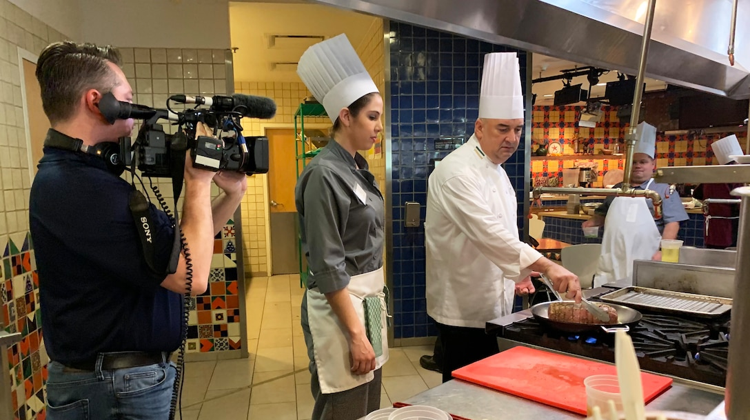 Air Force Installation and Misson Support Center videographer James Truitt captures interaction between a chef and Air Force student during a recent Techniques of Healthy Cooking Class at the Culinary Institute of America's San Antonio campus. (U.S. Air Force photo by Debbie Aragon)