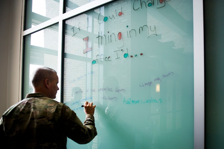 Maj. Gen. James A. Jacobson, Air Force District of Washington commander, writes a suggestion  in the Jones Building lobby during the first AFDW Innovation Summit at Joint Base Andrews, Md., June 12, 2019. (U.S. Air Force photo by Master Sgt. Michael B. Keller)