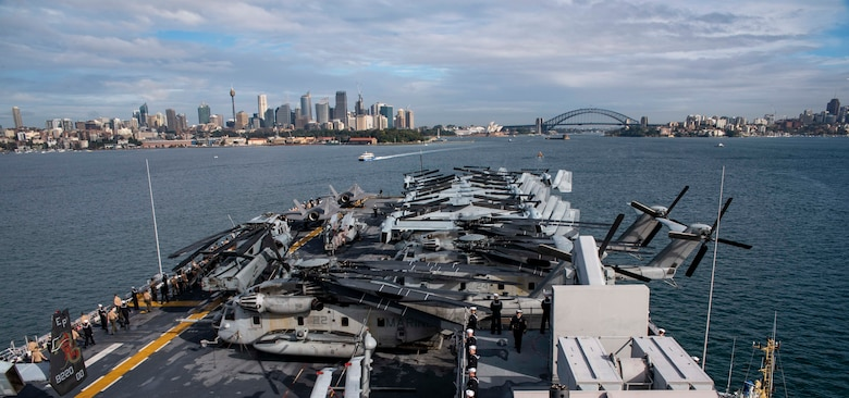 190618-N-OX029-1008 SYDNEY (June 18, 2019) – Sailors and Marines man the rails aboard the amphibious assault ship USS Wasp (LHD 1) as it arrives in Sydney for a port visit. Wasp, flagship of the Wasp Amphibious Ready Group, with embarked 31st Marine Expeditionary Unit, is operating in the Indo-Pacific region to enhance interoperability with partners and serve as ready-response force for any type of contingency.