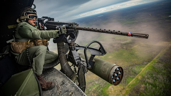 U.S. Marine Corps Sgt. Darrin Smith, a crew chief with Marine Light Attack Helicopter Squadron 775, Marine Aircraft Group 41, 4th Marine Aircraft Wing, operates a GAU-21/A during a live-fire event at Cold Lake Air Weapons Range, Alberta, Canada, June 15, 2019, in support of Sentinel Edge 19. The Marine Reserve plays a critical component to the Marine Corps' Total Force, and training such as SE19 helps ensure Reserve units combat effectiveness and proficiency for world-wide deployment.
