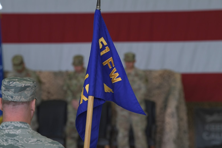 An Airman holds a 51st Fighter Wing emblazoned guidon during a change of command ceremony, June 18, 2019, at Osan Air Base, Republic of Korea. U.S. Air Force Col. John Gonzales, 51st FW commander, now leads the most forward deployed wing in the world, providing combat ready forces in support of the ROK. (U.S. Air Force photo by Staff Sgt. Greg Nash)