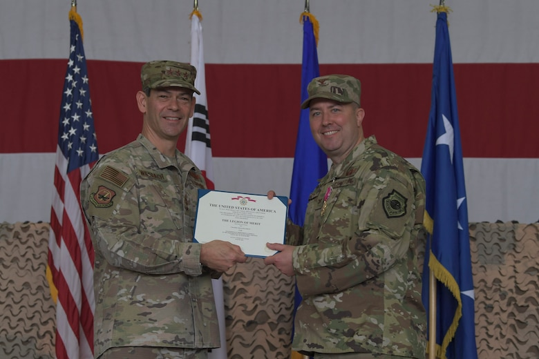 U.S. Air Force Lt. Gen. Kenneth Wilsbach, left, Seventh Air Force commander, presents a Legion of Merit certificate to outgoing 51st Fighter Wing Commander Col. William Betts, during a change of command ceremony, June 18, 2019, at Osan Air Base, Republic of Korea. U.S. Air Force Col. John Gonzales, 51st FW commander, now leads the most forward deployed wing in the world, providing combat ready forces in support of the ROK. (U.S. Air Force photo by Staff Sgt. Greg Nash)