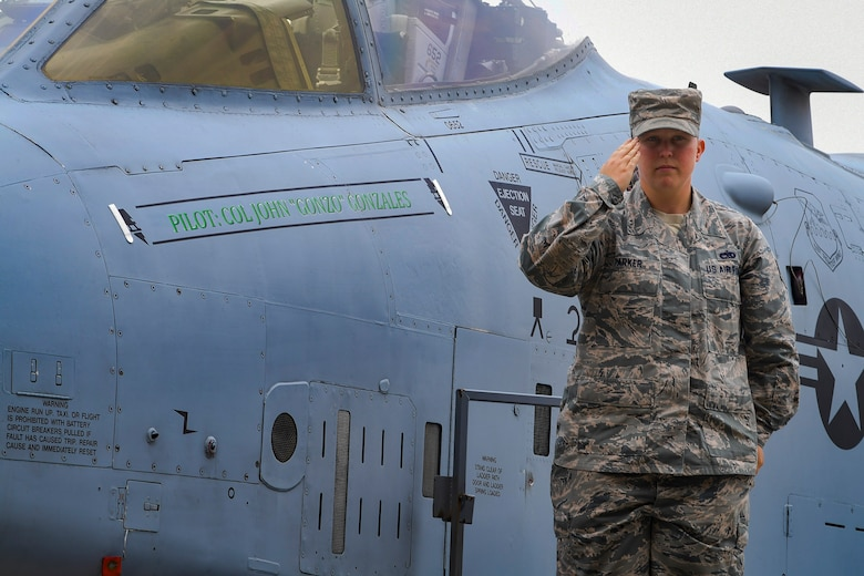 U.S. Air Force Staff Sgt. Victoria Parker, 51st Aircraft Maintenance Squadron A-10C Thunderbolt II crew chief, renders a salute after unveiling 51st Fighter Wing Commander Col. John Gonzales' name on his aircraft, June 18, 2019, at Osan Air Base, Republic of Korea. Gonzales, a prior 25th Fighter Squadron A-10C Thunderbolt II pilot, will again carry the Mustang tradition. Now, he leads the most forward deployed wing in the world, providing combat ready forces in support of the ROK. (U.S. Air Force photo by Staff Sgt. Greg Nash)