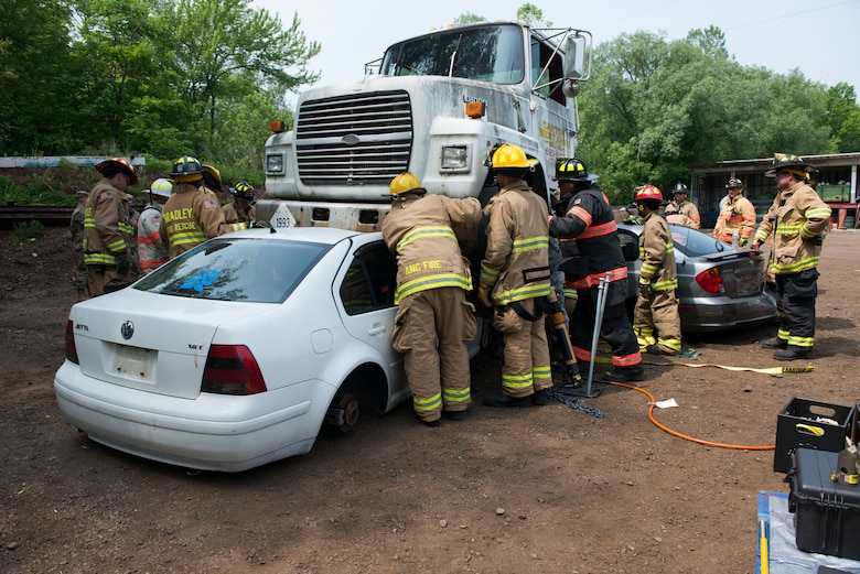 Fire Departments from Bloomfield, Blue Hills, East Granby, Suffield, and Bradley International Airport convened at Mark's Auto Parts to participate in a rescue strike team exercise led by the Connecticut Air National Guard Fire Department, June 1, 2019 in East Granby, Conn. The firefighters practiced various rescue techniques to ensure continuity in training across departments. (U.S. Air National Guard photo by Tech. Sgt. Tamara R. Dabney)