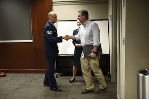 U.S. Air Force Tech. Sgt. Stacey Wakefield, a drill status guardsman with the 156th Aeromedical Evacuation Squadron, shake the hand of his civilian supervisor Mr. Chris Mendlik after organizing a surprise ceremony to present the ESGR Patriotic Employer Award at the Wells Fargo Charlotte Customer Information Center, NC, June 14, 2019. The Patriotic Employer Award is the first level that an employer can be nominated for, and reflects the efforts made to support citizen warriors through a wide-range of measures including flexible schedules, time off prior to and after deployment, caring for families, and granting leaves of absence if needed.