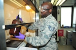 Staff Sgt. Lavert Octetree, 403rd Logistics Readiness fuels craftsman, swirls a fuel sample in a beaker, June 7, 2019, Keesler Air Force Base, Mississippi.  Petroleum, oil and lubricants team members handle, store, test, and distribute jet fuel, liquid oxygen and liquid nitrogen to aircraft on the flightline. (U.S. Air Force photo by Tech Sgt. Michael Farrar)