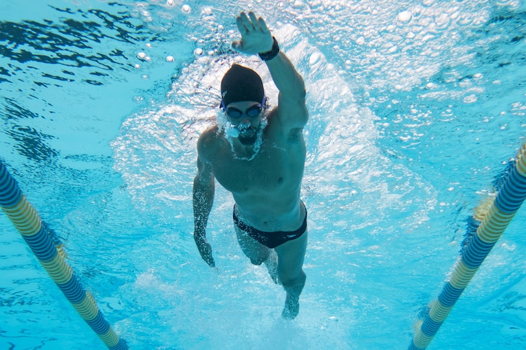 A swimmer does laps in a pool.