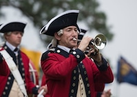 """A member of the U.S. Army Old Guard Fife and Drum Corps plays the trumpet during the """"Music Under the Stars"""" concert series at Joint Base Langley-Eustis, Virginia, June 13, 2019."""