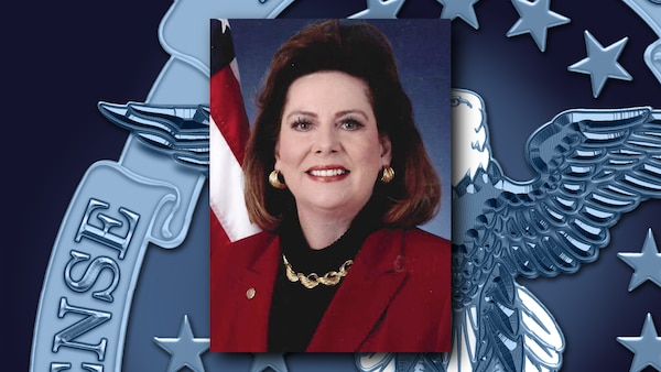 A portrait of Sharon Murphy over a background featuring the DLA emblem