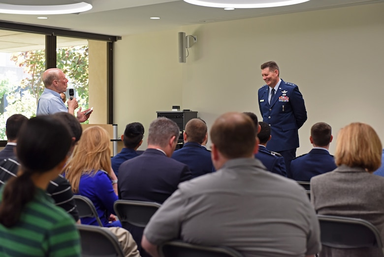 Lt. Gen. David Thompson, Air Force Space Command vice commander, laughs at a joke told by a University of Pittsburgh professor during a Q&A session in Pittsburgh, Pennsylvania June 14, 2019.