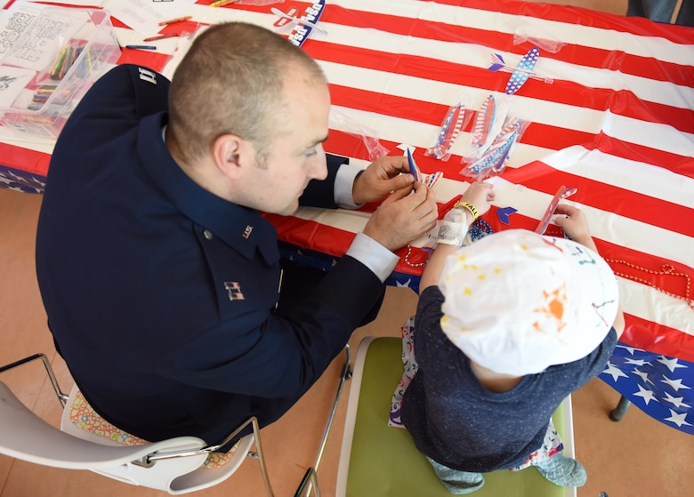 Capt. Justin Lewis, public affairs officer assigned to Secretary of the Air Force Public Affairs, interacts with a patient at Children's Hospital of Pittsburgh, June 14, 2019.