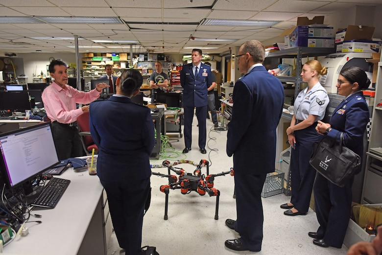 A robotics professor with Carnegie Mellon University briefs Lt. Gen. David Thompson, Air Force Space Command vice commander, and other Air Force members on developments in robotics in Pittsburgh, June 14, 2019.
