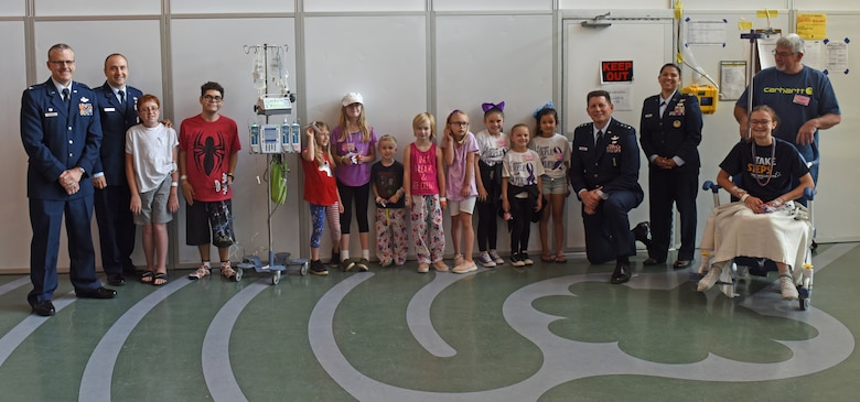 911th Operations Group Commander Col. Gregory Buchanan, Public Affairs Officer Capt. Justin Lewis, Air Force Space Command Vice Commander Lt. Gen. David Thompson, and Executive Assistant Capt. Marcianna Pease pose for a photo with patients and their families at Children's Hospital of Pittsburgh, June 14, 2019.