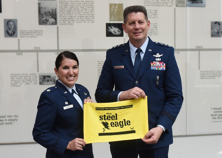 Lt. Col. Diana Bishop, commander of Air Force ROTC Detachment 730, presents a gift to Air Force Space Command Vice Commander Lt. Gen. David Thompson in Pittsburgh, June 14, 2019.