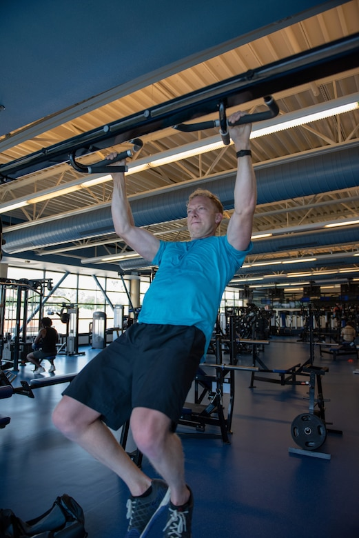U.S. Air Force Capt. Christopher Williston, a 21st Airlift Squadron C-17 Globemaster III pilot from Baton Rouge, Louisiana, performs pull ups during a workout June 13, 2019, at Travis Air Force Base, California. Williston is training to compete in the Alpha Warrior Western Regional Competition June 21 at Hill AFB, Utah. (U.S. Air Force photo by Tech. Sgt. James Hodgman)