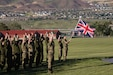 Soldiers from the United Kingdom and Canada perform Trooping the Colour in observance of the Queen's birthday during Panther Strike, June 8, 2019 at Camp Williams, Utah. Panther Strike is an annual exercise organized by the 300 Military Intelligence Brigade, that is centered upon developing the skill level of active duty and reserve military intelligence Soldiers and units. (U.S. Army photo by Sgt. Nathan Baker)