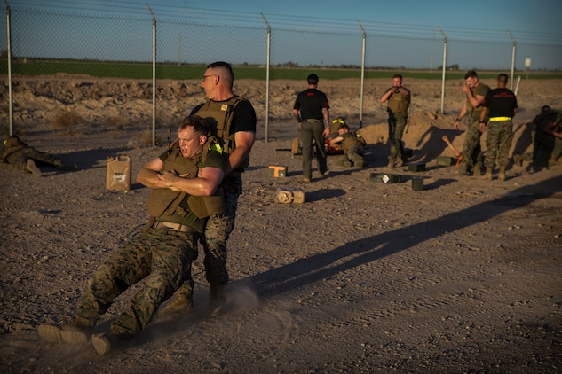 U.S. Marines stationed at Marine Corps Air Station (MCAS) Yuma conduct a Casualty Evacuation run as part of their physical training during Corporals Course at MCAS Yuma, Ariz., May 15, 2019. Corporals Course is a leadership class designed to teach Marines the fundamentals of being a noncomissioned officer. (U.S. Marine Corps photo by Pfc. John Hall)