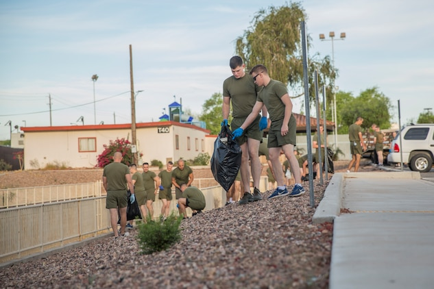 U.S. Marines with Headquarters & Headquarters Squadron (H&HS) conduct a base wide clean up at Marine Corps Air Station (MCAS) Yuma, Ariz., May 15, 2019. The base clean up is intended to boost unit morale and ensure the cleanliness of MCAS Yuma. (U.S. Marine Corps photo by Cpl. Sabrina Candiaflores)