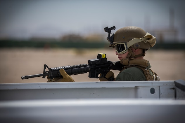 U.S. Marines with the Provost Marshal's Office, Headquarters and Headquarters Squadron, Marine Corps Air Station (MCAS) Yuma, conduct Special Reaction Team (SRT) vehicle assault training on MCAS Yuma, Ariz., May 16, 2019. The SRT is comprised of military police personnel trained to give an installation commander the ability to counter or contain a special threat situation surpassing normal law enforcement capabilities. (U.S. Marine Corps photo by Pfc. John Hall)