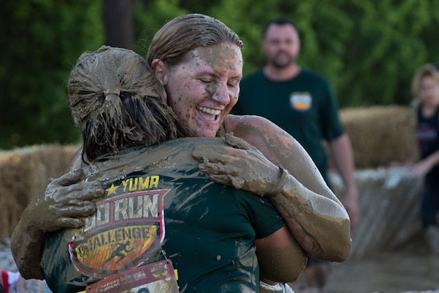 U.S. Marines, Sailors, and Civilians participate in the Marine Corps Air Station (MCAS) Yuma Mud Run at MCAS Yuma Ariz., May 18, 2019. The Mud Run consisted of various obstacles for all of the participants in both the competitive and non-competitive events. (U.S. Marine Corps photo by Lance Cpl. Joel Soriano)