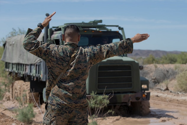 U.S. Marines with Marine Wing Support Squadron (MWSS) 371 participate in a Mud and Fording Course at Cibola Lake Mud course and Fording Basin, Yuma Proving Grounds Ariz., May 21, 2019. The mission of the MWSS-371 Mud and Fording Course is to enhance motor vehicle proficiency while in a wet and humid environment. (U.S. Marine Corps photo by Lance Cpl. Joel Soriano)
