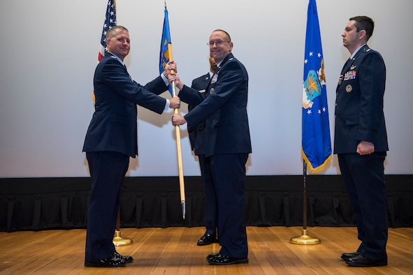 During a Change-of-Command Ceremony at the Joint Base McGuire-Dix-Lakehurst base theater, 14 June, Lt. Col. Gary P. Beckett relinquished command of the Northern Recruiting Squadron to Lt. Col. Timothy Martin. The Squadron commander leads a team of 100 Airmen spread throughout twenty states who recruit For the Air Force Reserve.