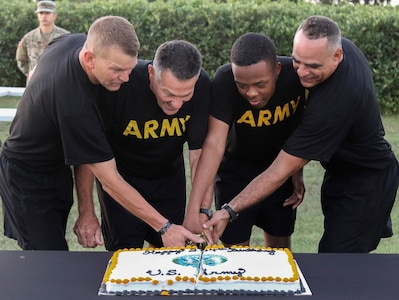 """The oldest and youngest Soldiers present, Col. William Bruce (second from left), deputy director for Dental Directorate G-3/5/7, and Spc. Dazhir Walker (second from right), a musician with the 323d Army Band """"Fort Sam's Own,"""" joined Lt. Gen. Jeffrey S. Buchanan (far left), commanding general, U.S. Army North (Fifth Army), and ARNORTH Command Sgt. Maj. Alberto Delgado (far right)in the cake cutting ceremony after the Army Birthday Run June 13. Approximately 2,000 Soldiers celebrated the 244th Army Birthday with a 3 1/2-mile run and were joined by Airmen from throughout JBSA, as well as civilians, friends and family members. The run is one of several events the Army units participated in to celebrate the Army's birthday June 14."""
