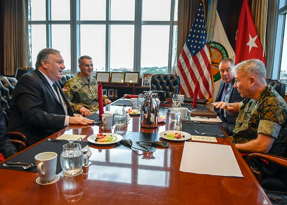 U.S. Marine Corps Gen. Kenneth F. McKenzie Jr., U.S. Central Command (USCENTCOM) commander, right, and U.S. Army Gen. Richard D. Clarke Jr., U.S. Special Operations Command commander, second from left, hosted Secretary of State, Mike Pompeo, June 18, at USCENTCOM headquarters. They engaged in discussions regarding military and diplomatic affairs throughout the Middle East region. The visit is a scheduled engagement intended to align the U.S. Government's diplomatic and defense efforts. (U.S. Air Force photo by TSgt. Dana Flamer)