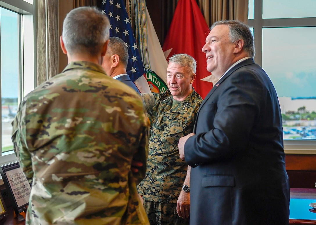 U.S. Marine Corps Gen. Kenneth F. McKenzie Jr., U.S. Central Command (USCENTCOM) commander, hosted Secretary of State, Mike Pompeo, June 18, at USCENTCOM headquarters. They engaged in discussions regarding military and diplomatic affairs throughout the Middle East region. The visit is a scheduled engagement intended to align the U.S. Government's diplomatic and defense efforts. (U.S. Air Force photo by TSgt. Dana Flamer)