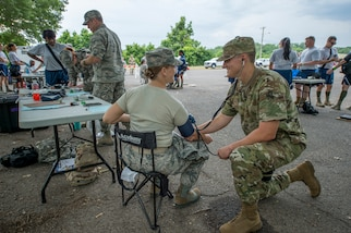 Members of the 116th Medical Group, Detachment 1, check participants' vital signs during FEMA exercise Shaken Fury 2019 on June 5 in Millington, Tenn. Forty-four medical and communications personnel with the 116th Air Control Wing, Georgia Air National Guard, served on the CBRNE Enhanced Response Force working alongside more than 200 Georgia National Guard soldiers, testing the synergy necessary to support the community during natural disasters like the simulated earthquake in the exercise. (U.S. Air National Guard photo by Tech. Sgt. Nancy Goldberger/RELEASED)