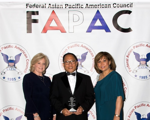 Hunstville, Ala. (May 16, 2019) Naval Surface Warfare Center, Philadelphia Division (NSWCPD) employee Kim Yee was recognized with the 2019 Federal Asian Pacific American Council (FAPAC) Excellence in Individual Achievement, GS 13-15 Category award for his efforts in promoting diversity and for his leadership. Yee (middle) accepted the award from Jody Singer, Director of NASA Marshall Space Flight Center (left) and Olivia Adrian, president of FAPAC (right). (Photo courtesy of Thong Vu, FAPAC)