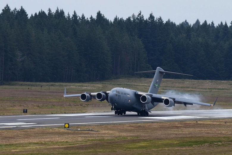 The first aircraft lands on the newly resurfaced runway at McChord Field, June 17, 2019, at Joint Base Lewis-McChord. McChord Field aircraft and Airmen continued operations at other west coast bases while the runway was resurfaced.  (U.S. Air Force photo by Airman 1st Class Sara Hoerichs)