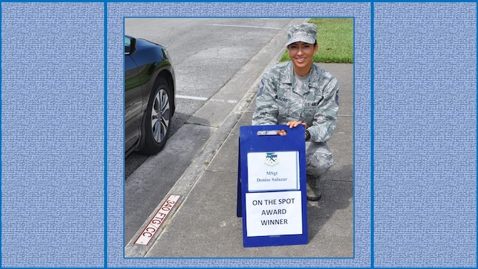 Master Sgt. Denise Salazar, 340th Flying Training Group Military Personnel Section, Career Development NCOIC, claims her turn in the boss' parking slot following her  selection as the 340 FTG May On-the-Spot Award winner. (U.S. Air Force photo by Janis El Shabazz)